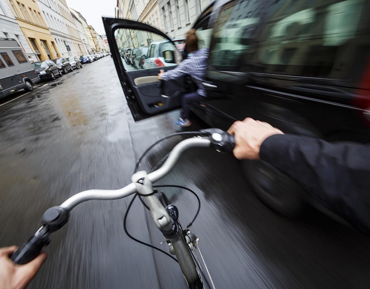 car door opening cyclist