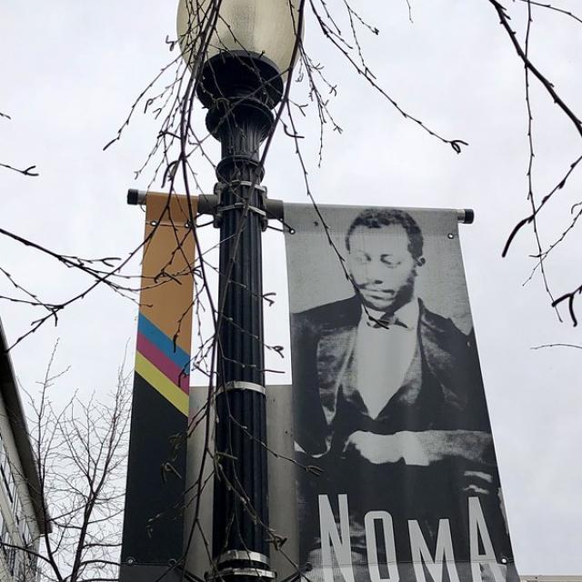 Noma: neighborhood banner, lamp post near NoMa-Gallaudet Metro station, Washington, D.C.