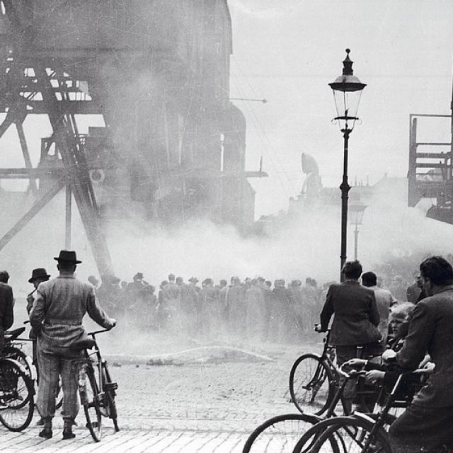 Sabotage. People looking at Langebro (bridge) in Copenhagen. 27th March 1945.